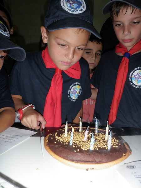 Kane blowing the candles out...