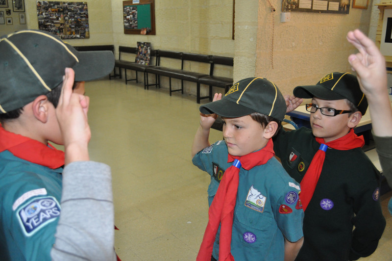 Black Six sixer Tom saluting Kane for inspection