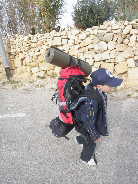 Struggling to carry his kit..hehe