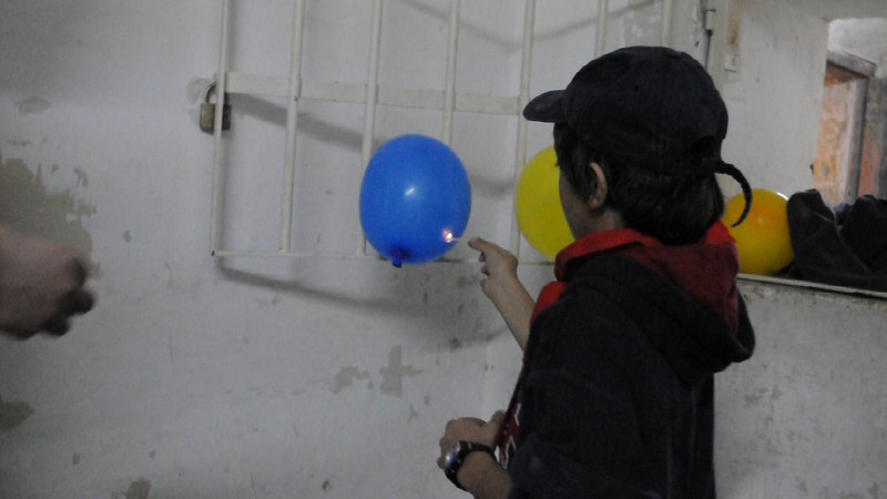 VIDEO: Jacques bursts his balloon without water in it as part of the 2nd experiment. Balloon with no water bursts BUT a balloon with a bit of water in it won't burn when a lit matchstick is placed under it.