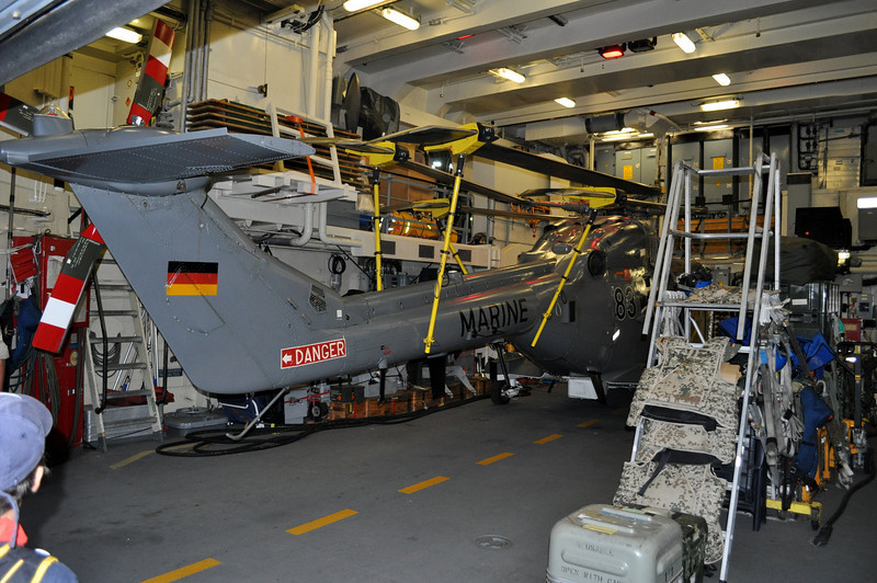the helicopters on board the warship....parked in their 'garage'.