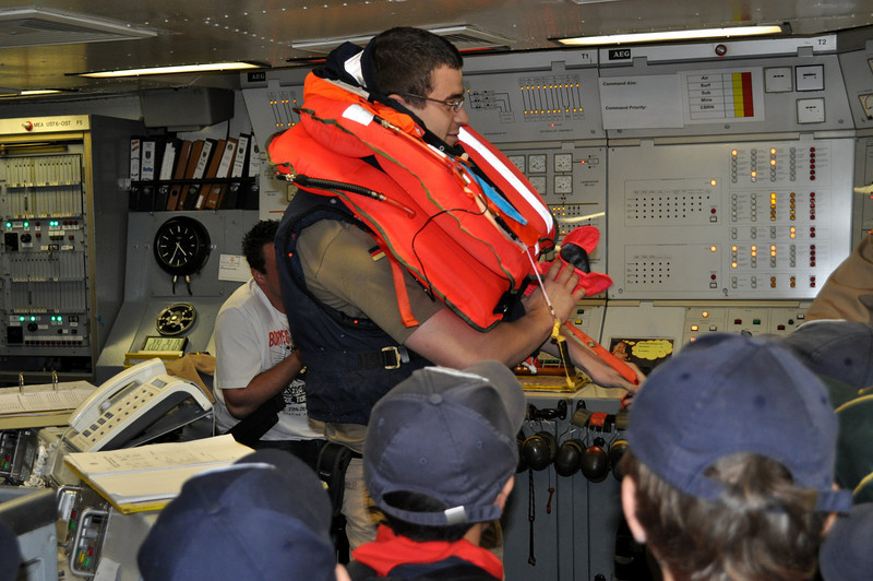 the Cubs asked many questions...and one of them was regarding life jackets....sooo...they kindly demonstrated how to wear one of their very original and different life jackets....well....suit!
