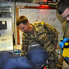 one of the marines showing us how to use the smoke apparatus which helps you breathe better