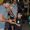 Matthias shaking hands with Akela upon receiving his award