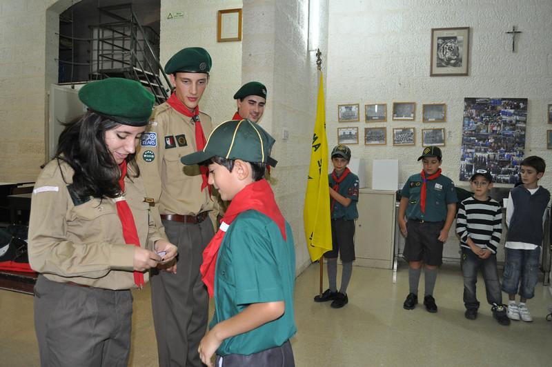 Raksha presents Mateo with his badges