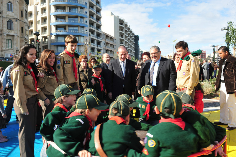 Prime Minister Lawrence Gonzi together with Minister George Pullicino watch over the Sliema Cubs whilst playing (Photo: MRRA)