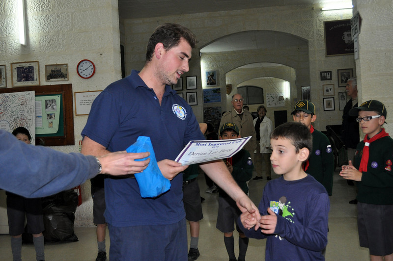 Derian receives his 'Most Improved Cub' award 2010...but he seems very interested in his gift!! :P