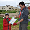 Tim receives his Most Dedicated Cub award from Akela David