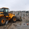 picking up waste material which then goes inside to be further separated and batched