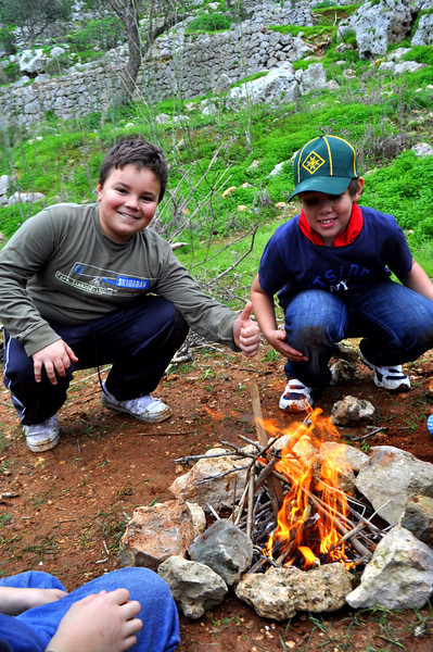 Michael and Timmy ecstatic to have started their first fire! Their facial expressions say it all :)