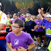 Preisdent George Abela leads the way for thousands of runners as he passes by the Sliema Cubs in Floriana during the 3rd Fun Run event