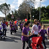 Parents, sisters, Cubs and leaders continue to walk towards the capital city