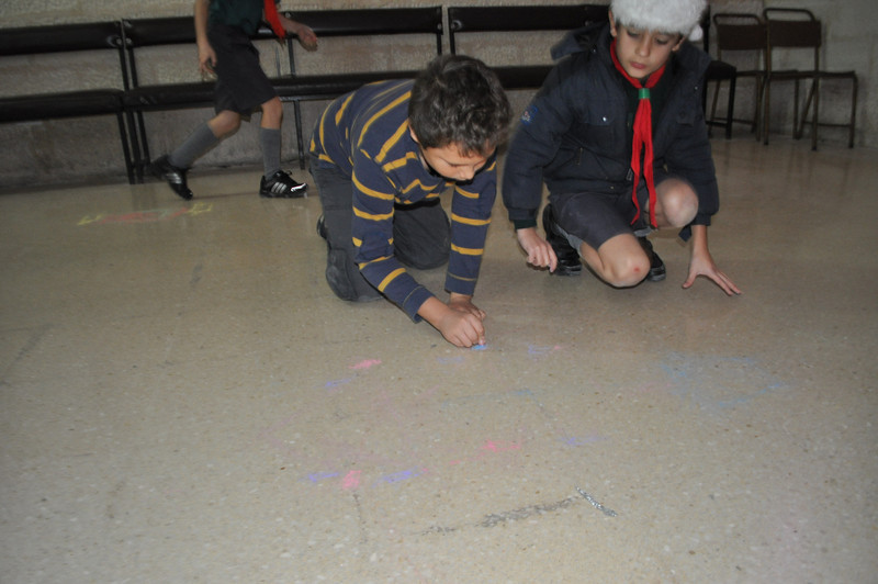 one of the games....todraw the best christmas tree using chalk