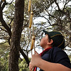 Michael determined to climb the rope ladder and reach the tree as part of the obstacle course