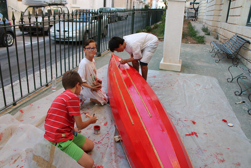The Troop painting a canoe that was donated to us by the wife of an Old Sliema Scout