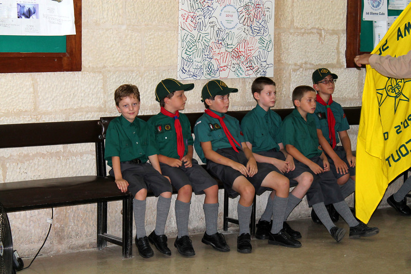 The recruits to be invested with their Sixers listening to what Akela has to say