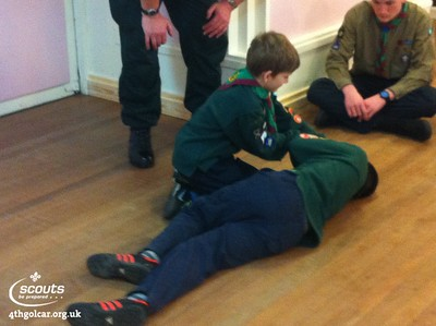 Tom 1 and Tom 2 demonstrating  how to clear an air way and put a person into the recovery position.