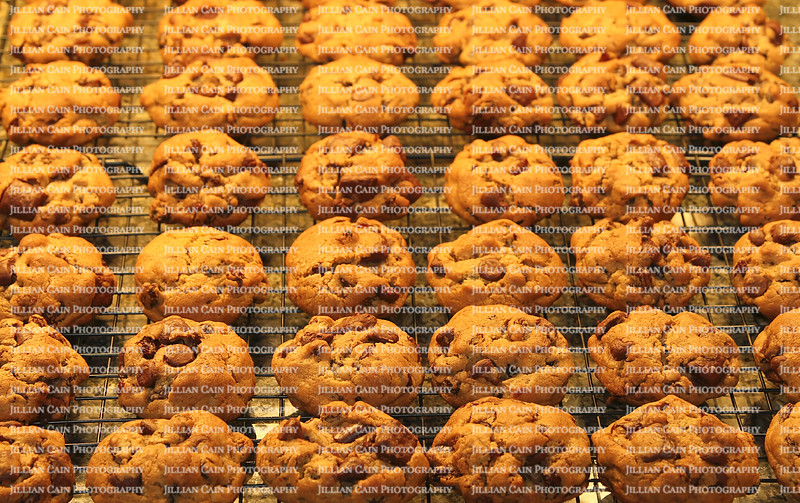 Dozens of professionally baked cookies on a cooling rack