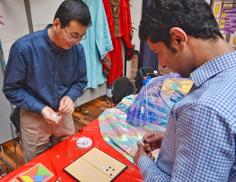 An international cultural feast you should not miss in K-State. A teacher and a guest were playing go. 4/12/2018 (Bill Zhu | Collegian Media Group)
