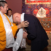 Burke Museum curator is given a prayer scarf by a Tibetan monk, November 2006.
