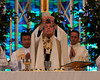 Archbishop Allen H. Vigneron elevates our Eucharistic Lord during Holy Mass at St. Michael's in Livonia, MI on September 11, 2010.  Detroit's archbishop led a prayer vigil organized by the Helpers of God's Precious Infants of Michigan.  Pictured behind the archbishop are Rev. Don Lacuesta (left), and Rev. Raymond Arwady.