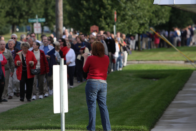 An abortion clinic worker is seen video taping the massive crowd on September 11, 2010 as they walked prayerfully to the abortion clinic following Mass.  The Mass was celebrated by Archbishop Allen H. Vigneron, who also led the vigil.