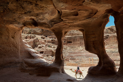 View of the amphitheatre in Petra from inside a cave