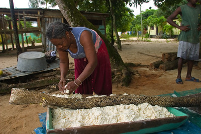 Stuffing the ruguma (or wowla) with grated cassava. This is to drain the cassava of its juice which is poisonous. The root cannot be consumed raw, since it contains free and bound cyanogenic glucosides which are converted to cyanide in the presence of linamarase, a naturally occurring enzyme in cassava.