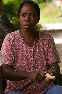 Garifuna woman peeling cassava in prepartion for the making of cassava bread.