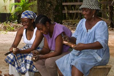 Garifuna women peeling cassava in preparation for the making of cassava bread.