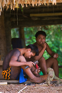 Embera men, carving. Chagres National Park, Panama.
