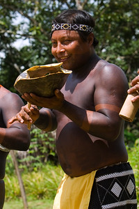 Embera men playing music, Chagres National Park, Panama.