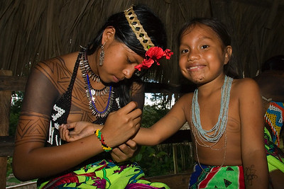 Embera gilrs painting dye on themselves. They dye not only serves as decorative art, but also as a bug repellant. Chagres National Park, Panama.