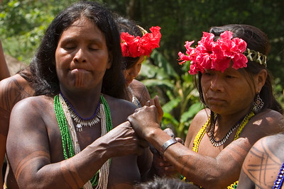 Embera men and women dancing, Chagres National Park, Panama.