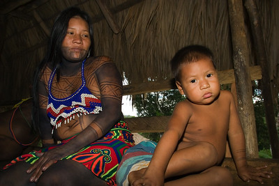 Embera boy with his mother, Chagres National Park, Panama.