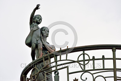 Cult-LOVE 00026 A wife with her child scan the horizon in hopes of seeing their husband and father returning home, to them, statue picture by Peter J Mancus