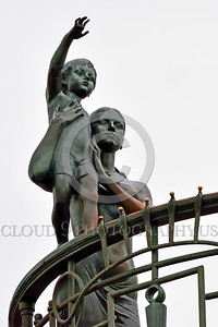 Cult-LOVE 00027 A wife with her child scan the horizon in hopes of seeing their husband and father returning home, to them, statue picture by Peter J Mancus