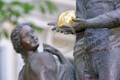 Cult-LOVE 00016 A wise woman carefully evaluates a man's inner world as he offers up his heart in love, statue picture by Peter J Mancus