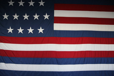 """US flag, Naval Academy  Based on eyewitness account, this flag was flown by Captain John Paul Jones aboard the frigate RANGER in 1778, when he sailed into quiberon Bay. The French fleet fired a nine gun salute to become the first time a foreign gevernment recognized the """"Stars and Stripes."""""""