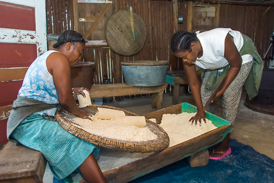 "Sifting (""ahibiha"" in garifuna) dry cassava on a ""hibisi"" (sifter) before it is to be baked."