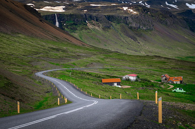 Road and waterfall near Útnesvegur