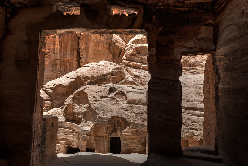 Looking across the Siq from inside a monument in Little Petra