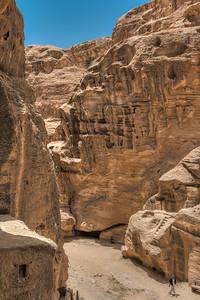 Man sitting in the shade in Little Petra, Ma'an, Jordan.