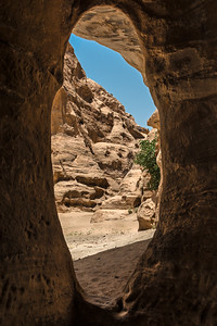 View of the Siq of Little Petra from inside a monument