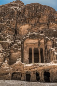 Sculpted columned chamber and cave-house of Little Petra
