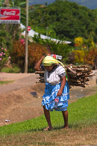 Maya woman carrying firewood, Maya Center, Stann Creek, Belize.