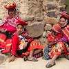 Local women and children in colorful traditional attire and saucer-shaped hats, Ollantaytambo, Inca Sacred Valley, Peru