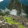 Machu Picchu ruins   cloaked in early morning mist with Huayna Picchu in the background, Peru