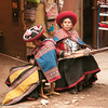 Weavers dressed in colorful traditional attire and saucer-shaped hats, Chinchero, Peru