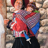 Young weaver dressed in traditional attire and her child, Chinchero, Peru